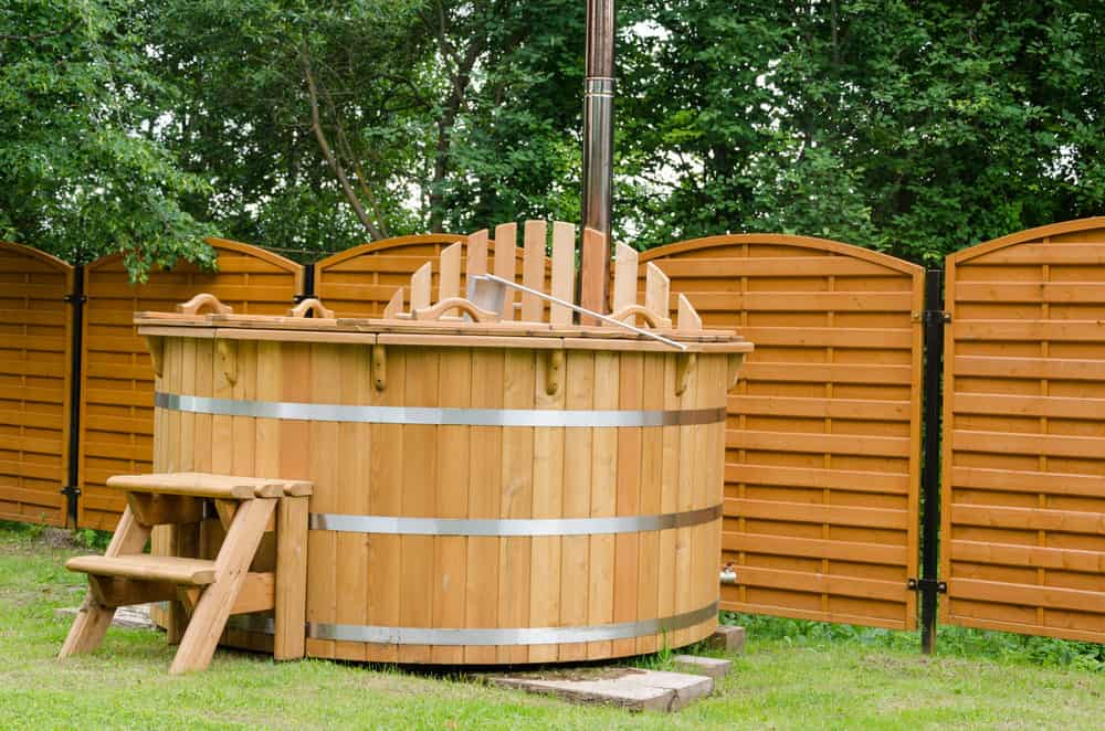 Wooden hot tub in the backyard