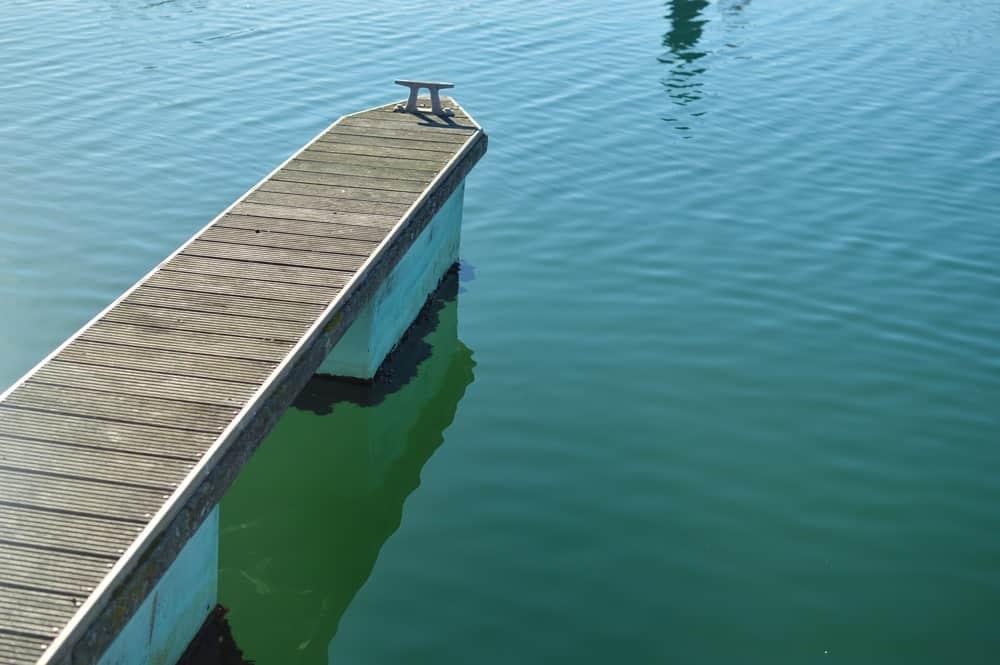 Aluminum dock on water.