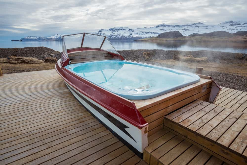 Boat hot tub outside the local guesthouse of Mjoeyri nearly Eskifjordur town of east fjord of Iceland