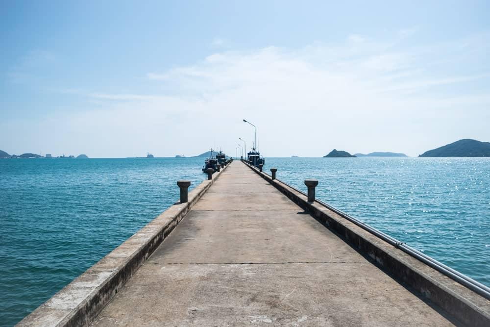 Concrete dock built on an ocean.