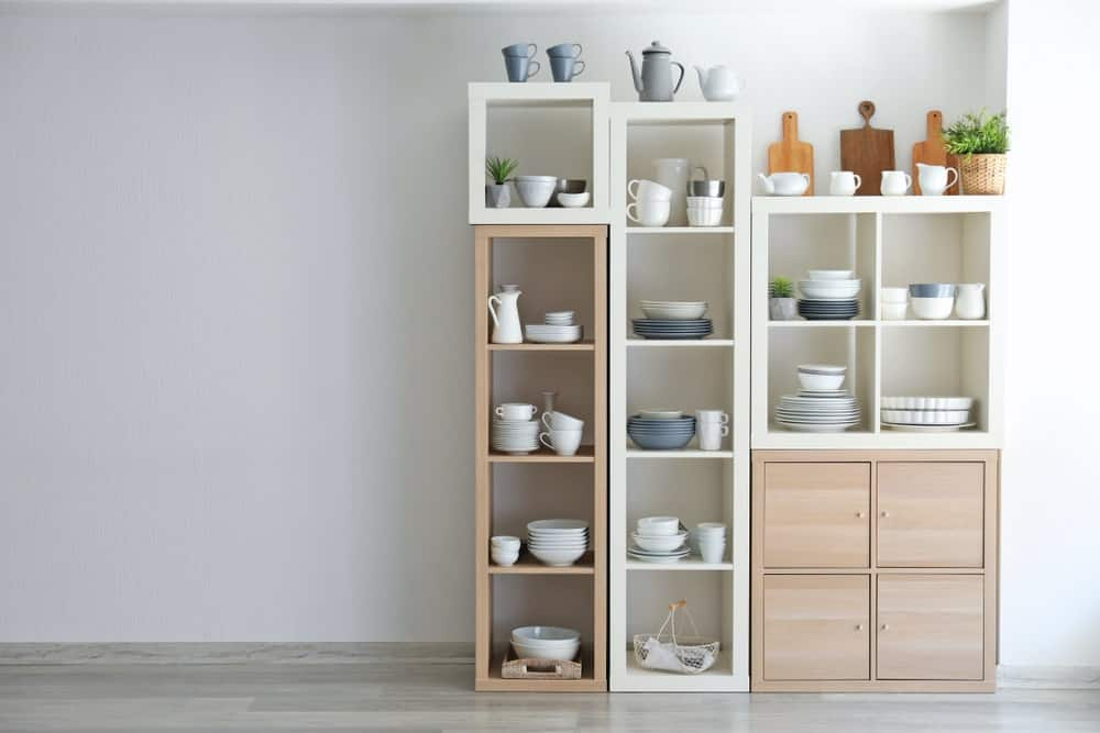 Decorative cubbies used to store and display matching dishware.