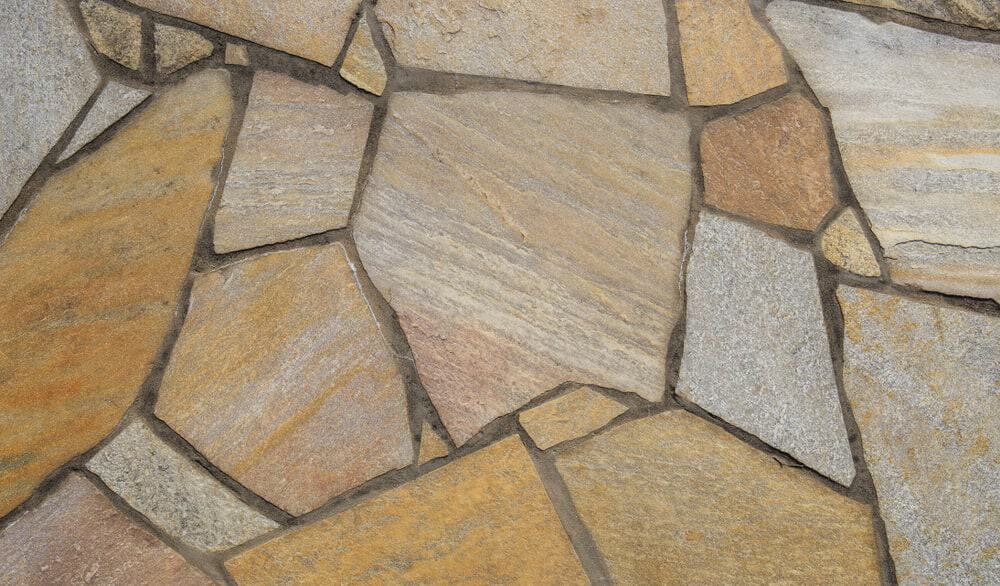 Closeup of a patio cut stone surface.
