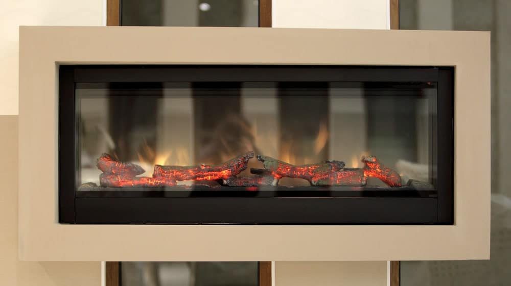 Artificial fireplace with fake fire logs