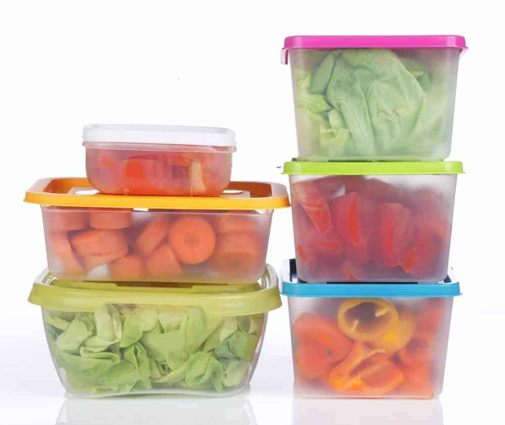 Different sizes of food storage containers with different types of food.