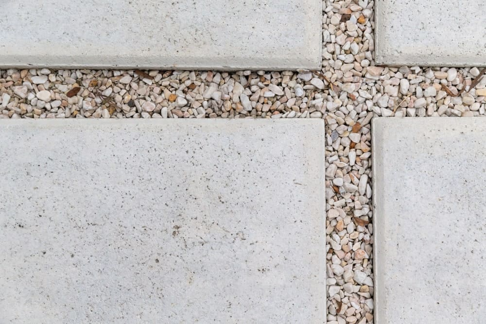 Gravel patio surface with some pebbles.