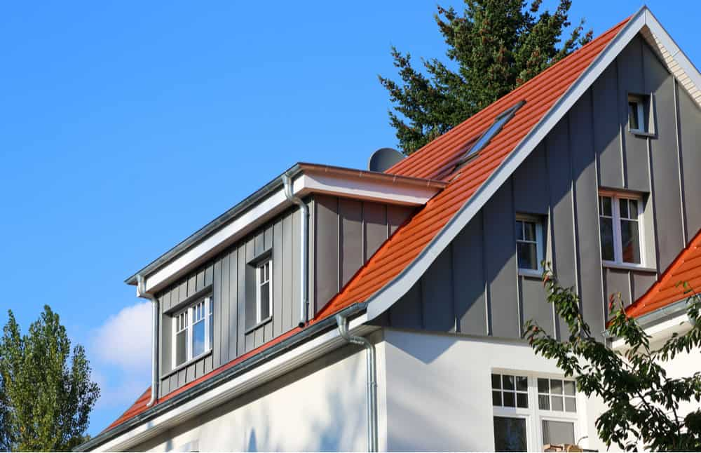 Example of a dormer window with a flat roof jutting out from the sloped gabled roof.