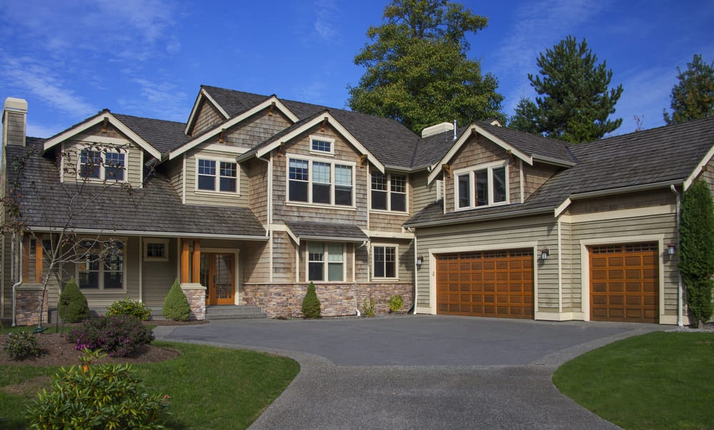Here's a contemporary mountain or Northwest style home with two dormer windows built into the roof. Because this house has many angles and roof lines, the dormer windows are not nearly as prominent as they are in other houses.