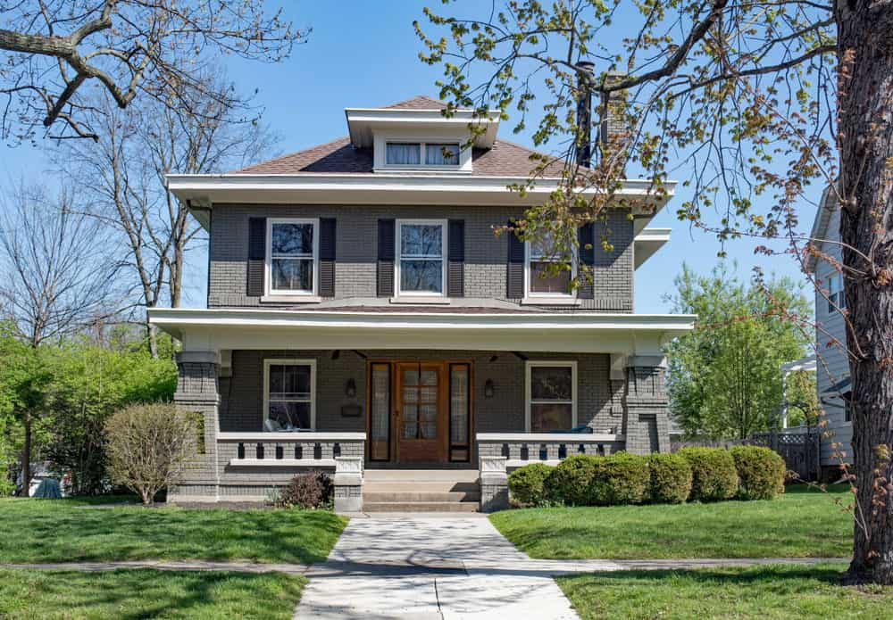 The American Four Square is well known for its hipped roof and single dormer windows on the front. This is a classic example. FYI, American Four Square homes fall under the Craftsman style.
