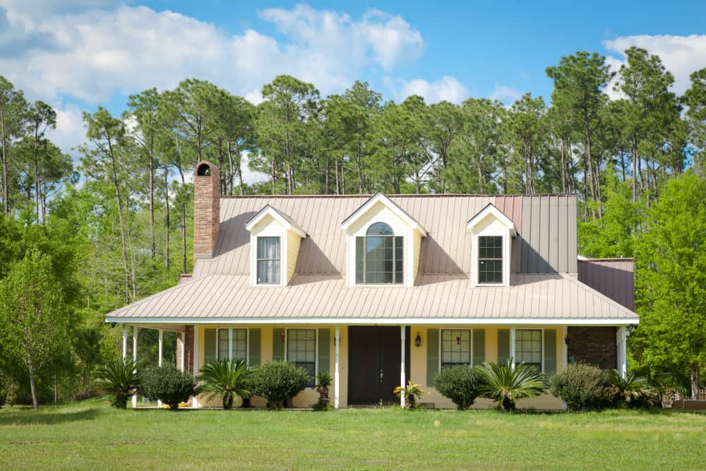 This image showcases an example of a home with two small dormer windows flanking one larger in the middle.
