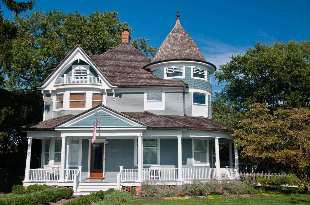 Here's an example of the lower part of the home being rounded corner with porch that rises up to a third story turret.