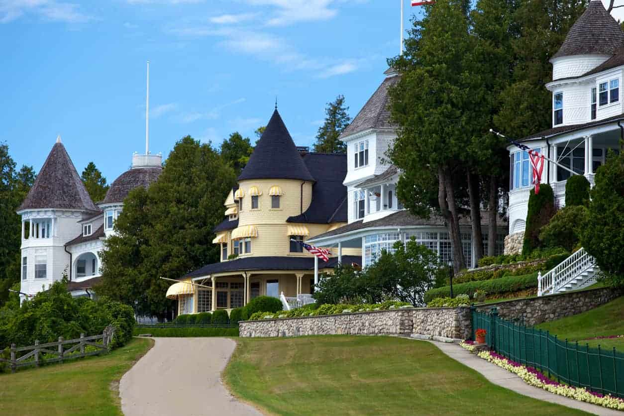 A row of mansions on Mackinac Island. Notice how almost all of them have a turret as part of the design.
