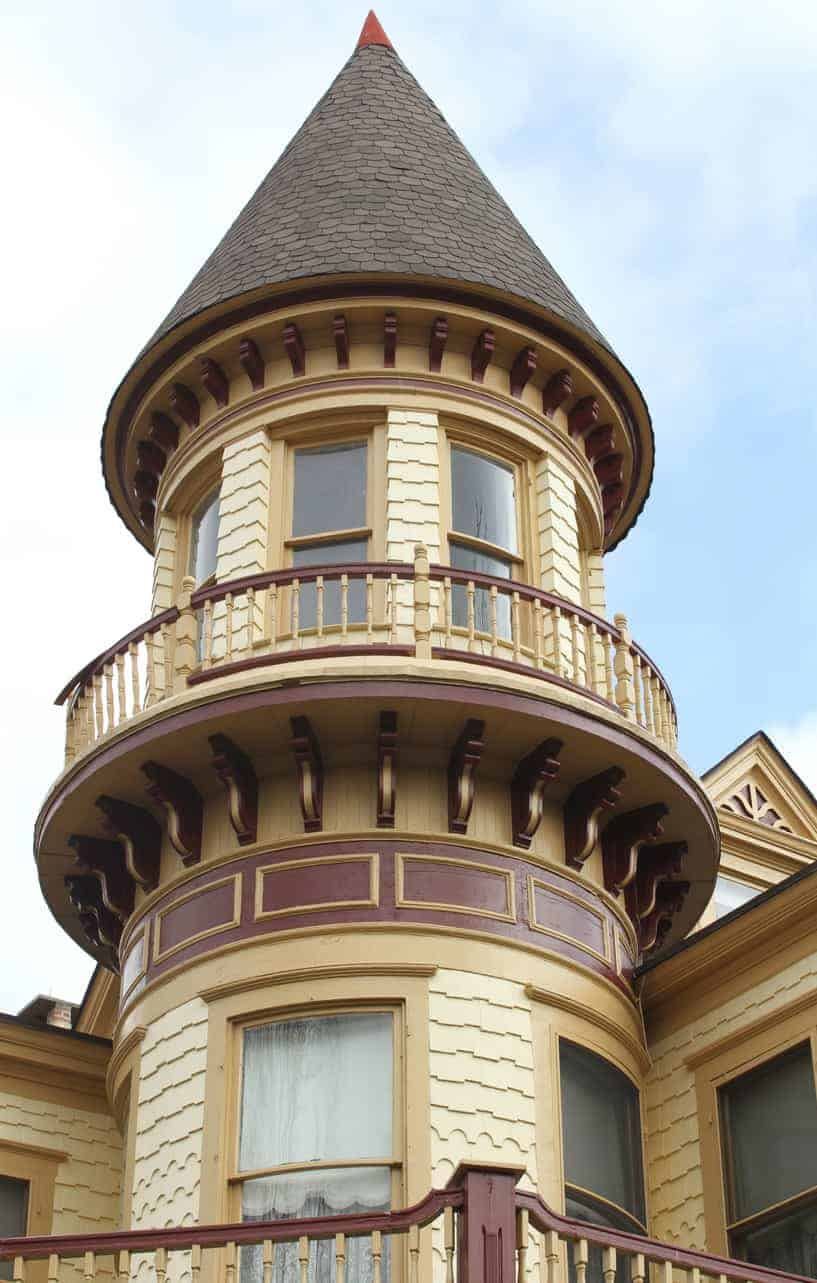 Here's a close-up of a turret that has a decorative balcony wrapping around the upper part of the structure.