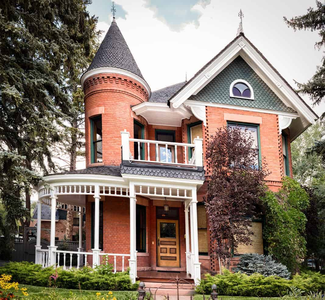Here's an old Victorian home with a narrow brick turret. The lower part of the turret includes and exterior curved porch.