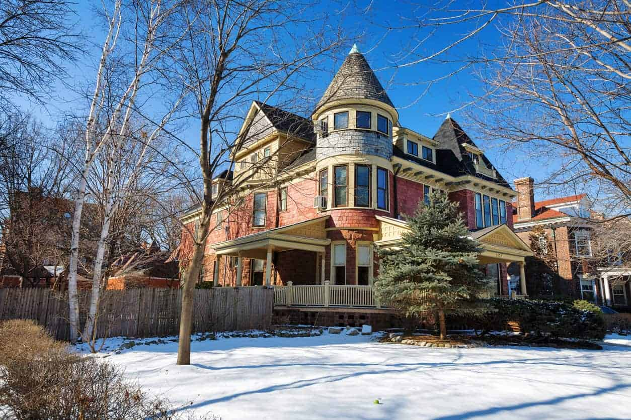 Queen anne stye mansion in hyde park chicago with a round turret feature that has