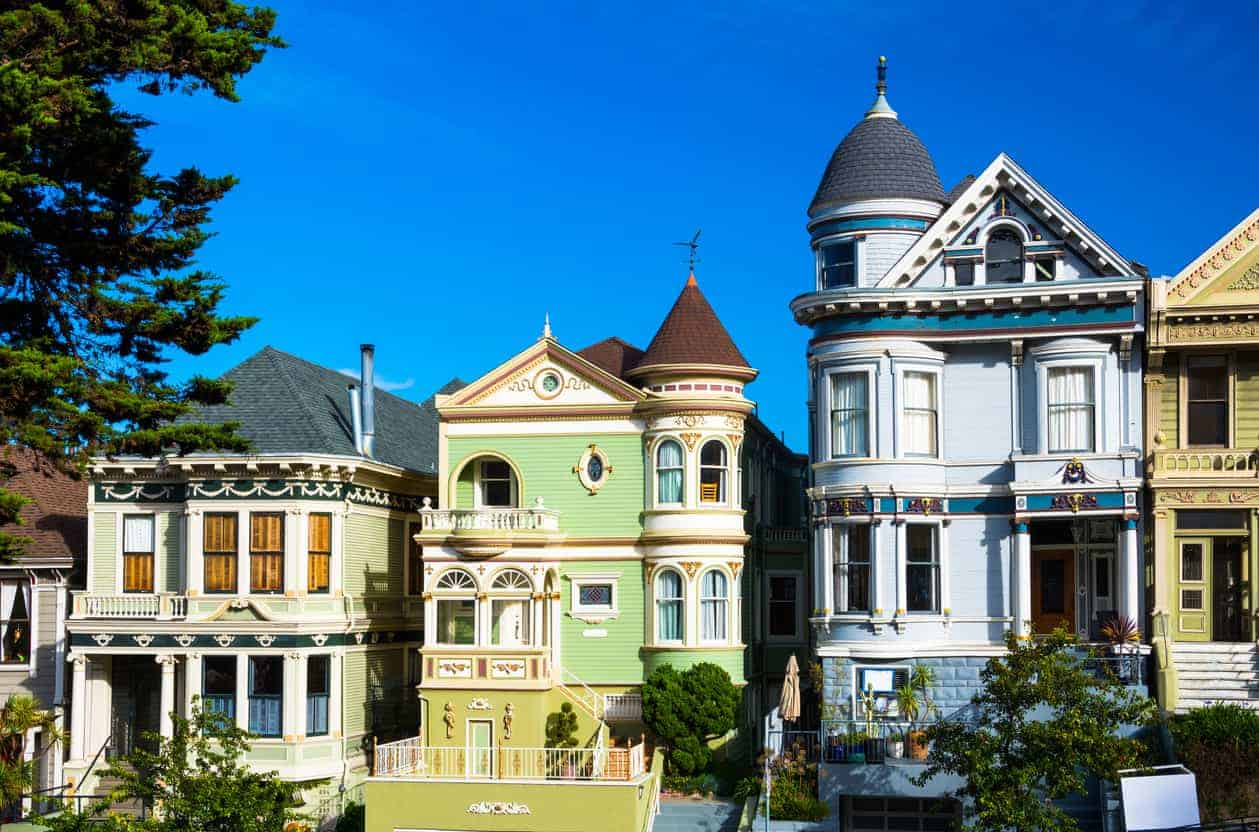 Two elaborate Victorian houses in Alamo Square in San Francisco. Notice the blue house on the right with its Eastern inspired turret.