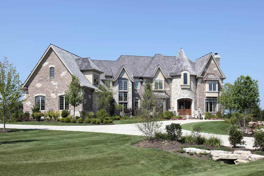 Here's a McMansion with large stone turret at the front door.