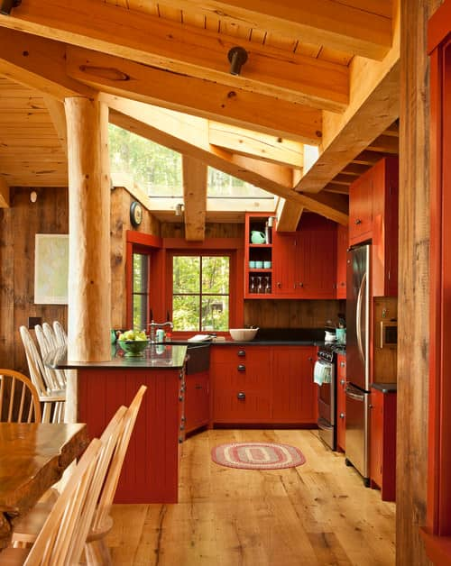 I love the light wood with the red kitchen cabinets that is contrasted with the black countertops. This is an example to create a red kitchen that is not overbearing with red.
