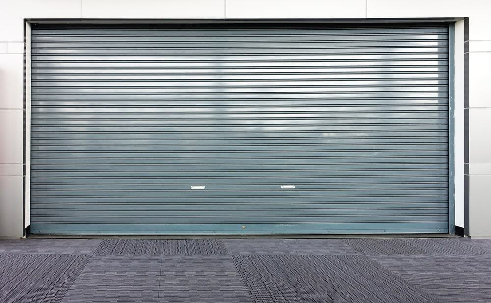 Garage with a sheet metal door.