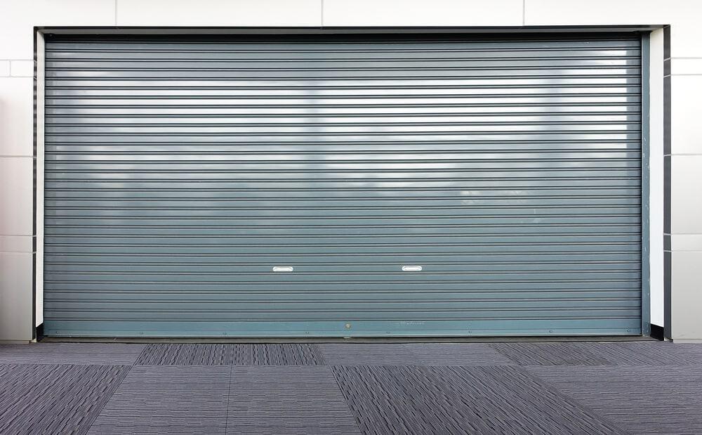 Garage with a sheet metal door.