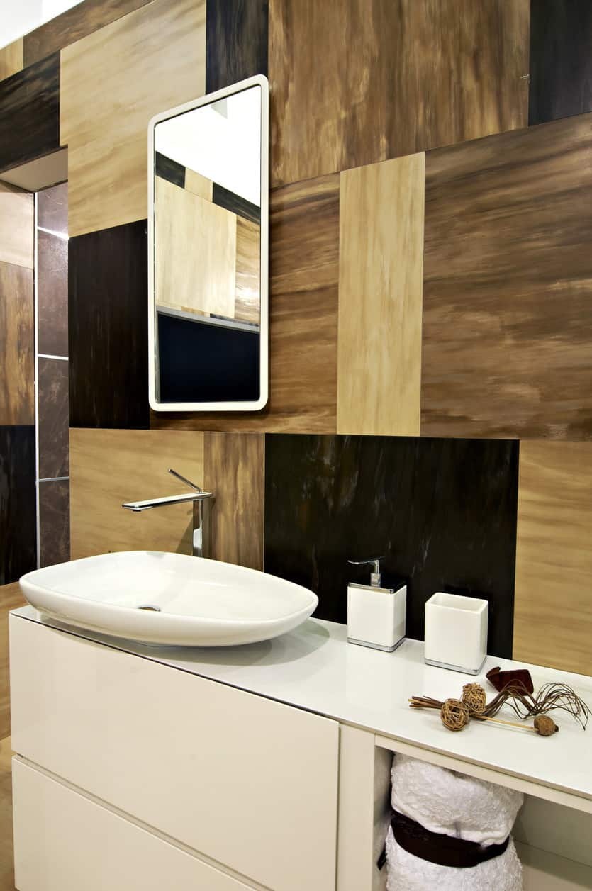Accent wall with different brown tones in geometric patterns.