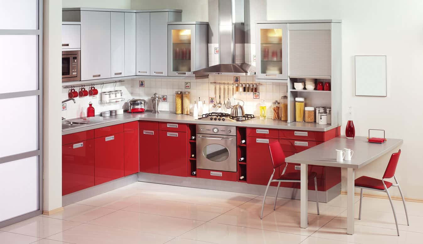 Fabulous small red apartment kitchen. Notice how only the lower cabinets are red and the uppers are light gray. I think that is a fabulous way to incorporate some color without it being overbearing.