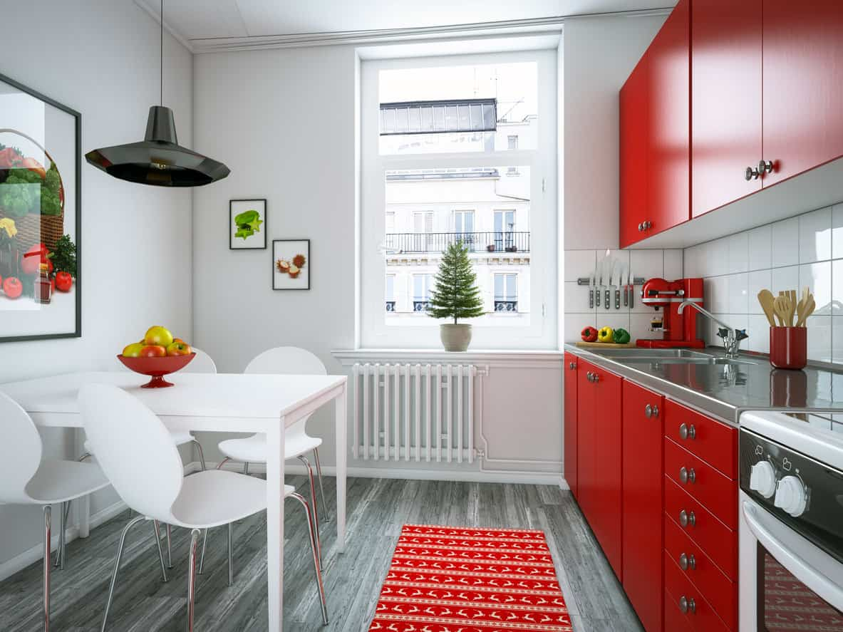 Cute Apartment Kitchen With Red Cabinets And White Liances There S Also A Bright