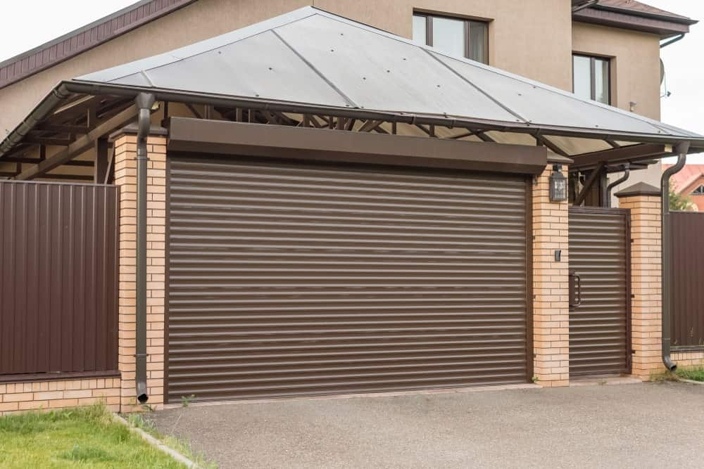 Garage with a roll-up screen door.