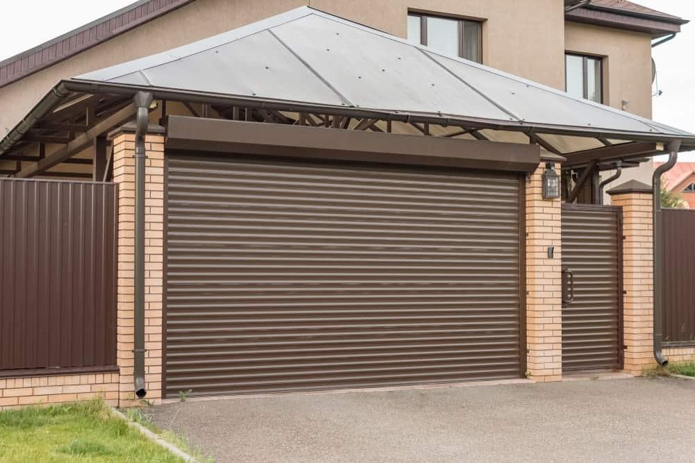 Garage with a roll-up screen door.