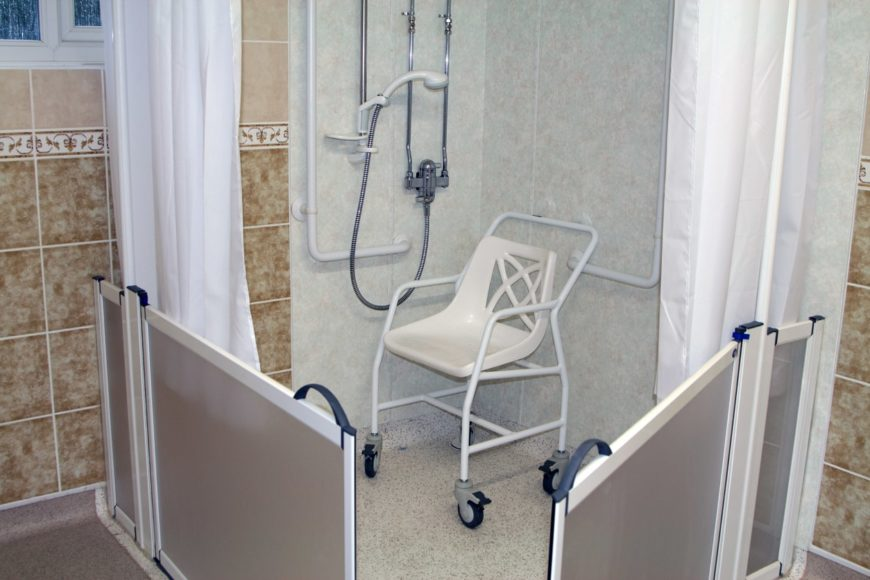 Shower for the disabled with shower chair.