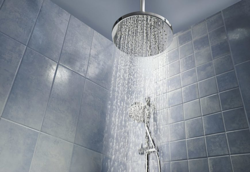 Water flowing from the shower head.