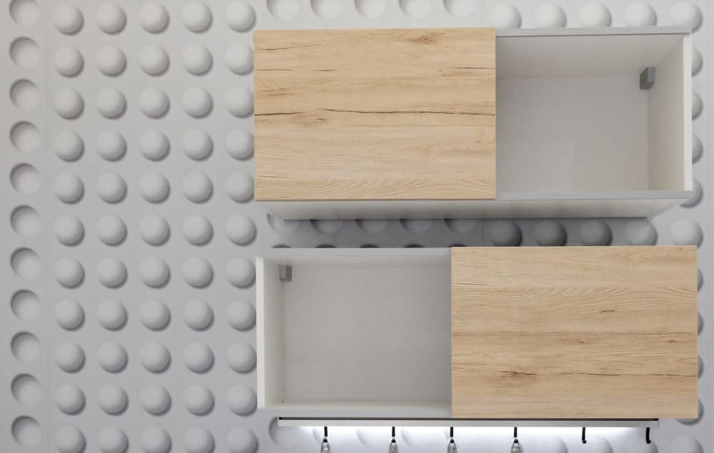 Sliding wooden doors for the reach-in pantry cabinets.