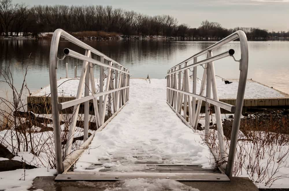 Ice-covered boat dock with steel frames.
