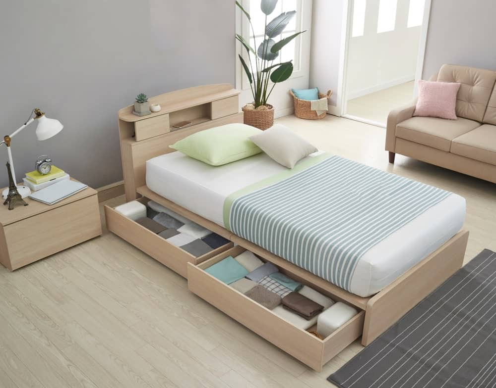 Storage bed with built-in drawers on the sides.