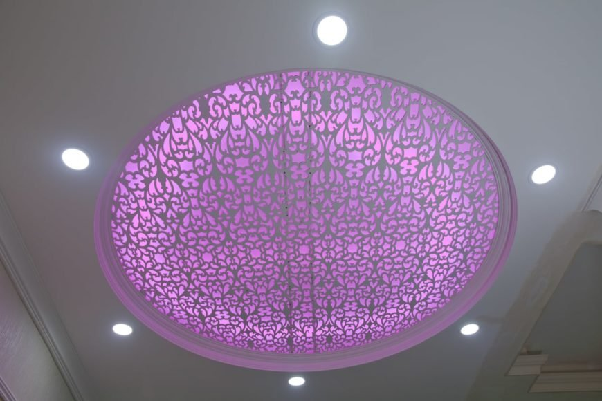 Decorative stretch ceiling with recessed lighting.