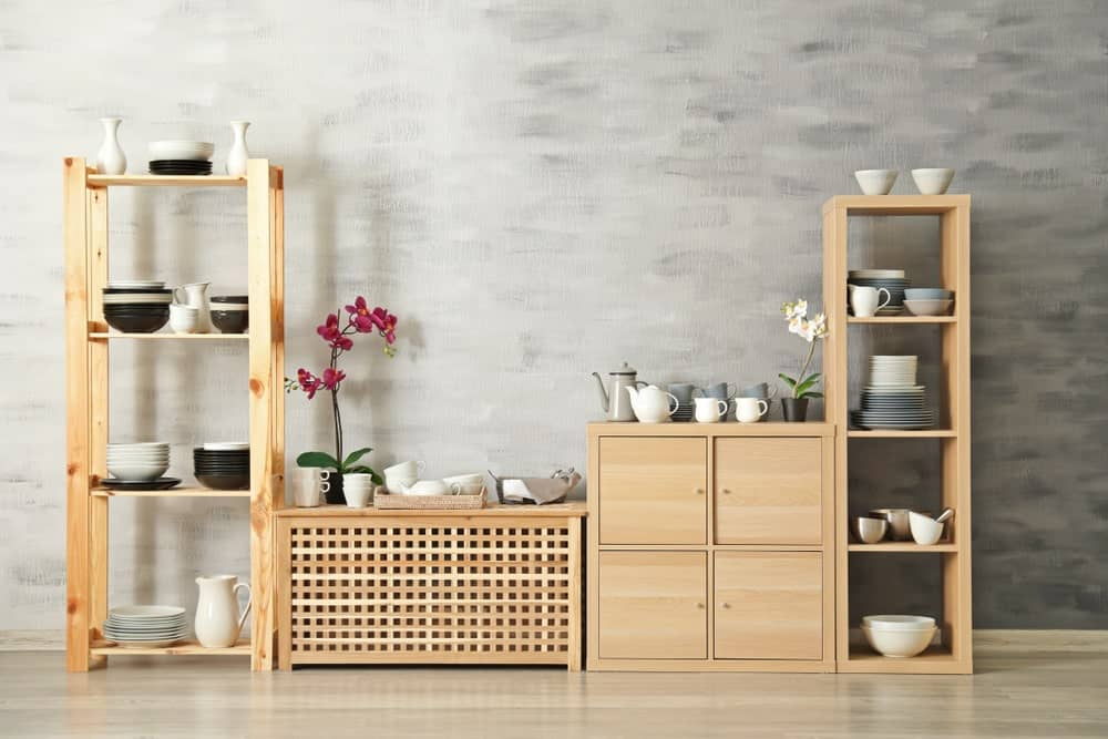 Wooden storage with matching dishware for decorative and functional purposes.