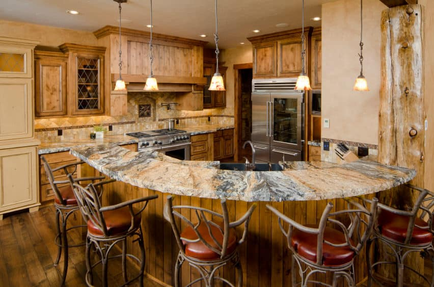 The crude and rudimentary style of the two-tiered kitchen island itself, the surrounding chairs and a strongly matching backdrop purveys the illusion of woodland wilderness which will pique the interest of outdoor enthusiasts and adventure seekers.