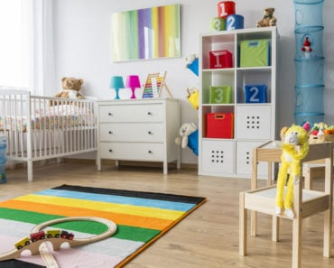 Baby nursery with plenty of nice baby furniture