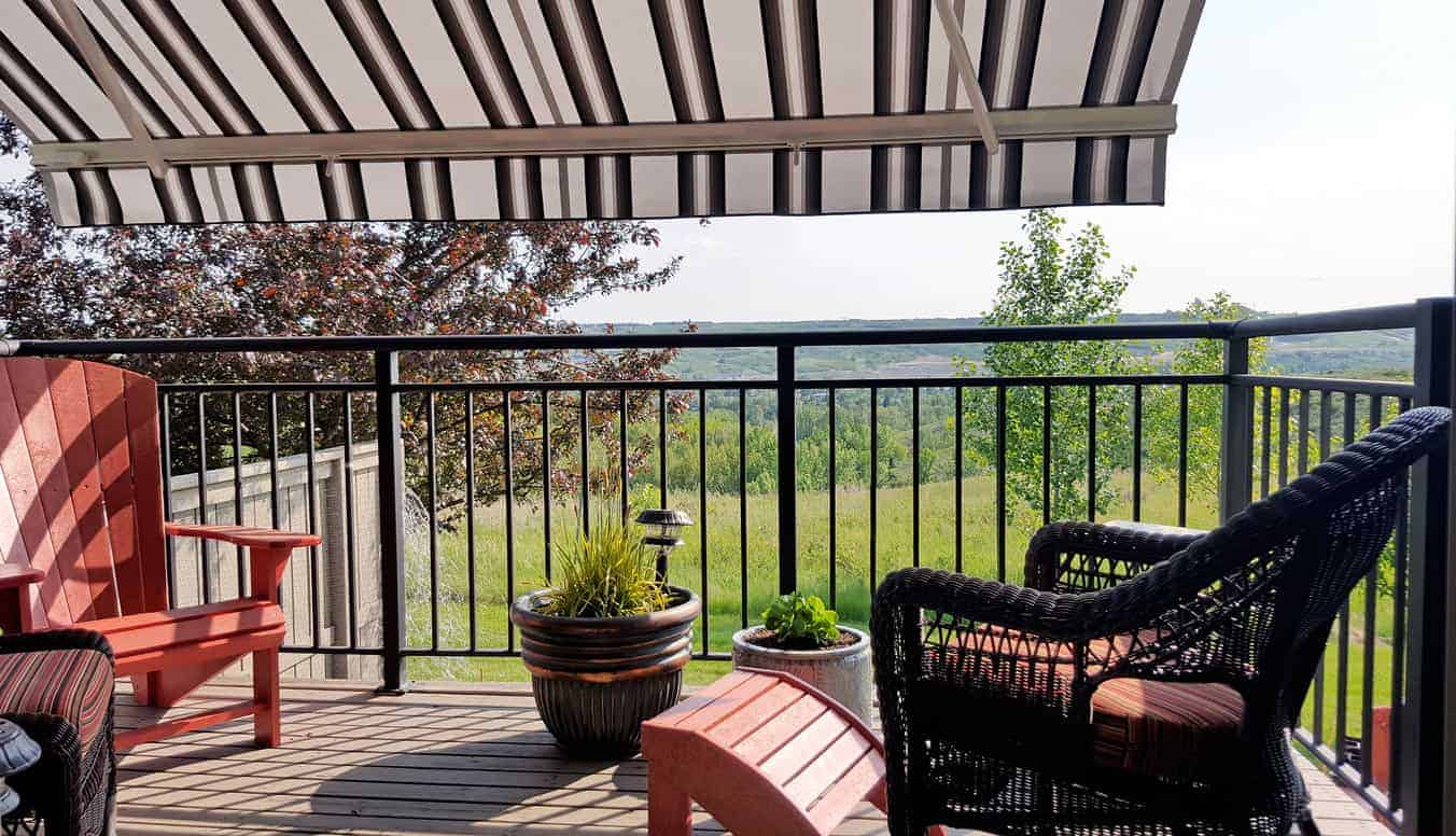 Small covered deck featuring classy seats overlooking the beautiful outdoor area.