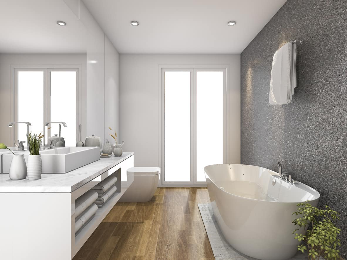 The judiciously designed translucent frosted windows liven up a serene ambience. Brilliantly placed gray wall contrasts with and blocks the austere purity of white and rustic hues.