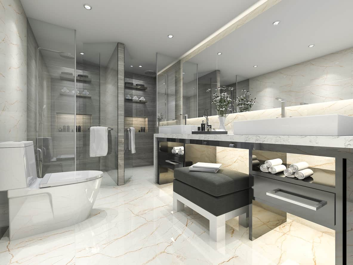 With well-placed mirrors and ingeniously crafted alcoves, this interior looks far more spacious than it really is. Well-designed recesses, striated tiles, metallic gray fixtures and gray-textured wallpaper impart a distinctly pleasant aesthetic appeal to the gorgeous interior.