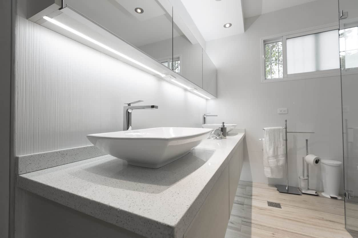 A touch of soothing light gray marvelously enlivens the prosaic monotony of white. Light gray marble slabs and wallpapers admirably embellish a distinctly white interior.