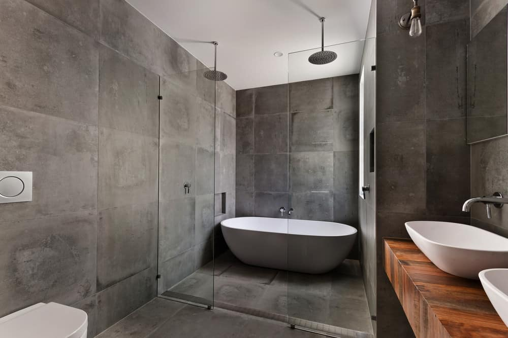 Fabulous smoky gray tiles abound in the flooring and walls with a view to compliment the rustic façade of the oaken wooden fixture. Resplendent gray tiles infuse a sense of liberation in this quixotic minimalist interior.