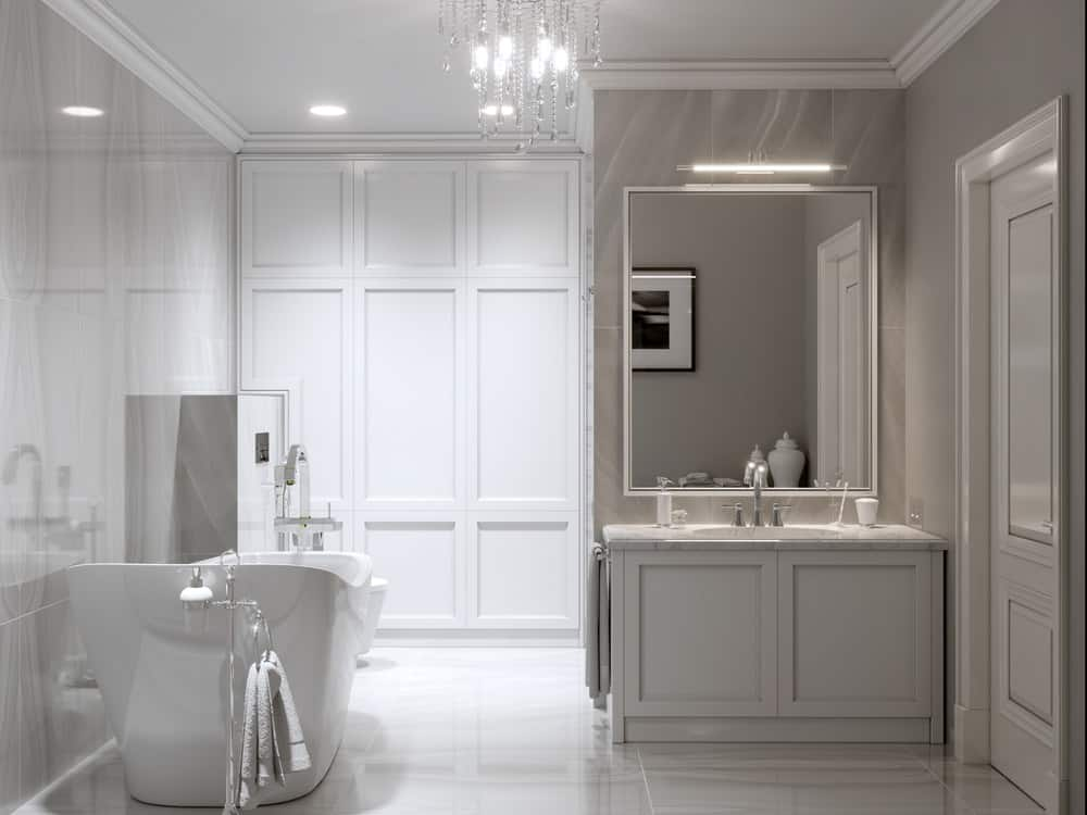 Vintage chandeliers, grayish beige marble, spacious tub, large mirror, marble slab topped vanity fixture and beige textured wallpaper exude imperial splendor. Purity of white has been augmented by the soft exquisite touch of light beige and the most subtle hues of gray to instill an almost soporific calm.