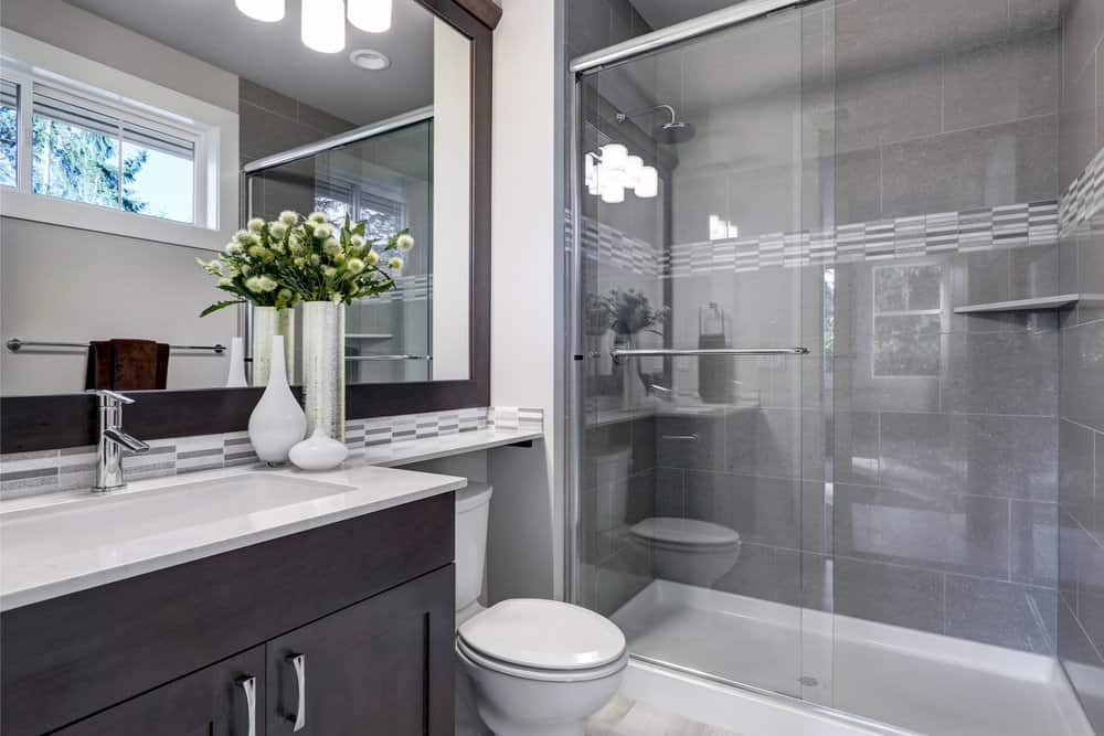 Eclectic contemporary design is leveraged to orchestrate a pacific ambience that is hypnotically exquisite. Scintillating stainless steel faucets, vanity fixtures of rare timber, gray colored granite tiles and a modern opulent façade reflect regal luxury.