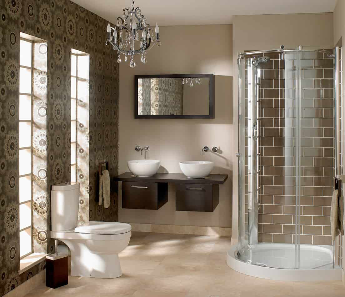 Brick castle elements and contemporary accents blend together in this beautiful master bath. An antique looking light fixture compliments the brown brick tiles that make up the walk in shower walls. A semi circle shaped glass panel encloses the shower giving it a real fancy castle looking effect.