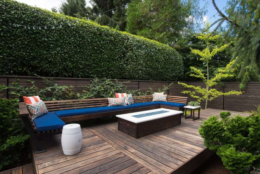 Contemporary style patio bench on a garden deck.