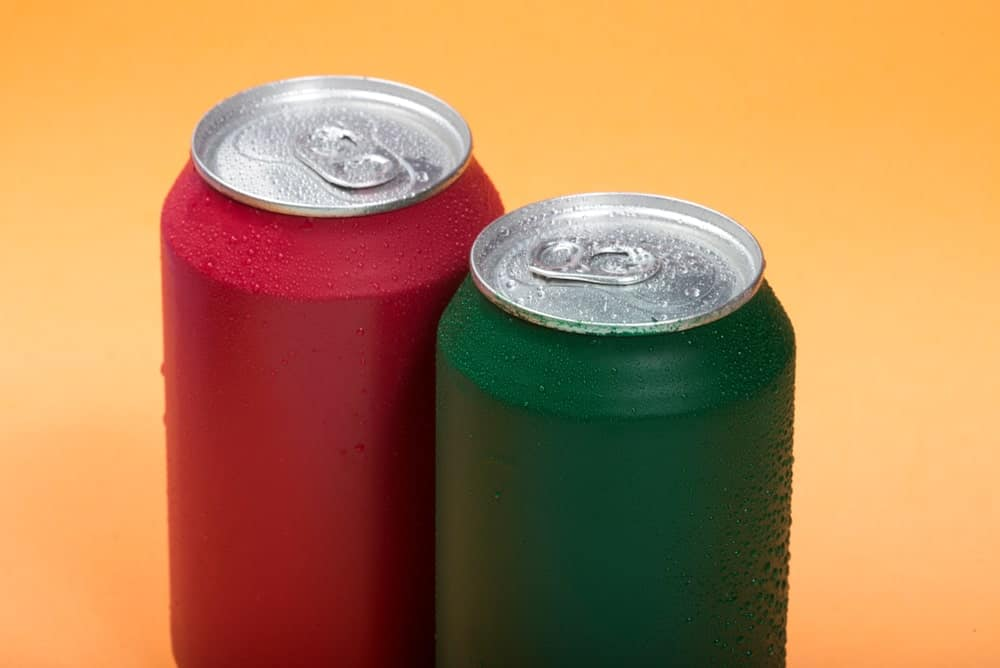 Red and green beverage cans.