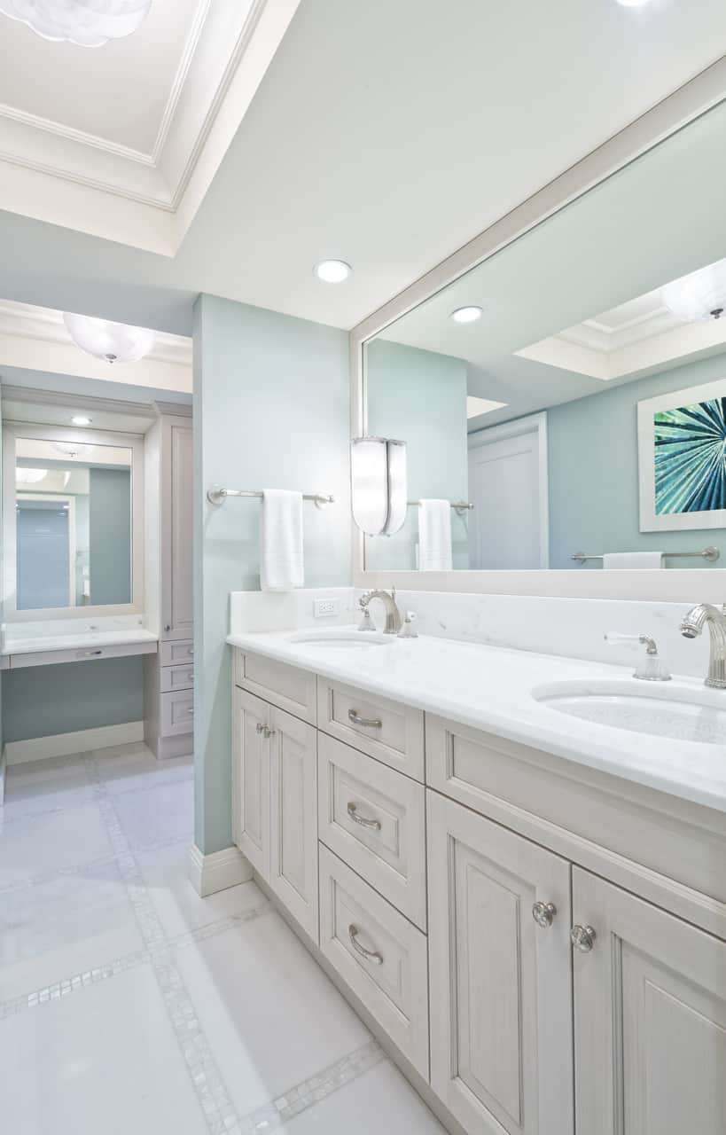 This stunning bathroom is very feminine and chic looking. From its pale pastel aquamarine walls, marble vanity and the bright turquoise artwork like frozen fractals (again), this bathroom exudes a very cool vibe — literally.