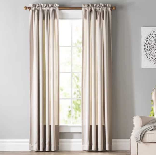 Floor to ceiling curtains on a bay window.