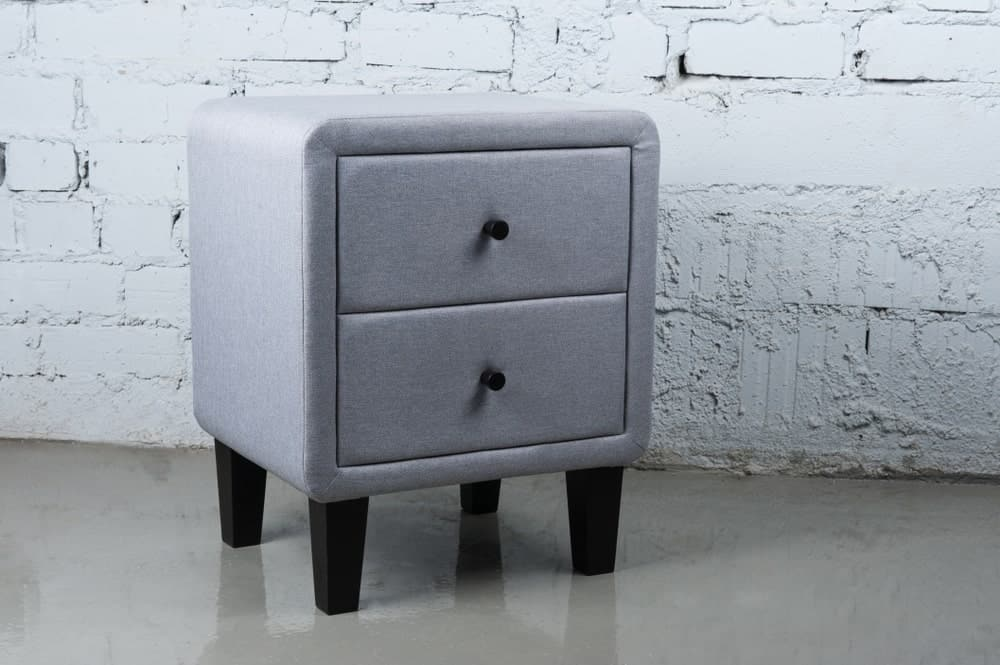 Fabric storage nightstand with drawers.